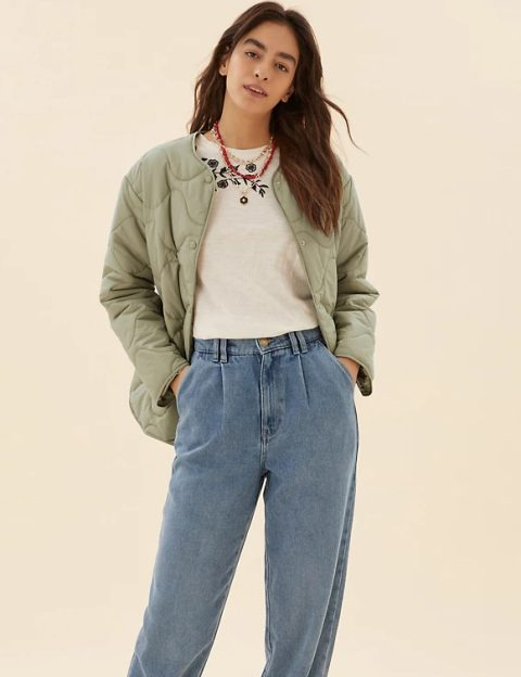 With floral printed shirt and light blue loose jeans