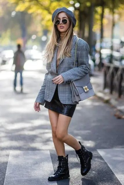 With gray beret, checked blazer, beige turtleneck, black leather mini skirt and chain strap bag