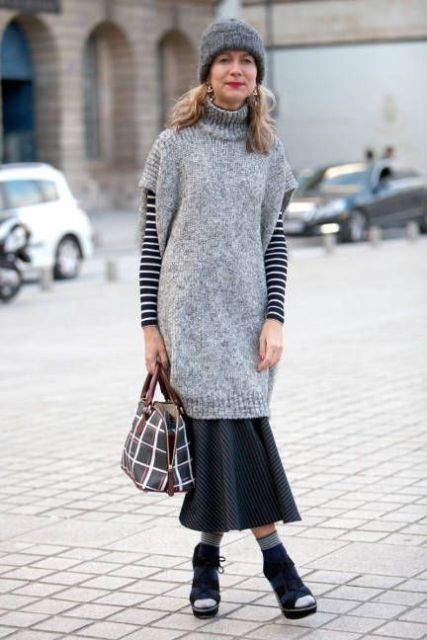 With gray hat, striped shirt, checked bag, printed midi skirt and high heels
