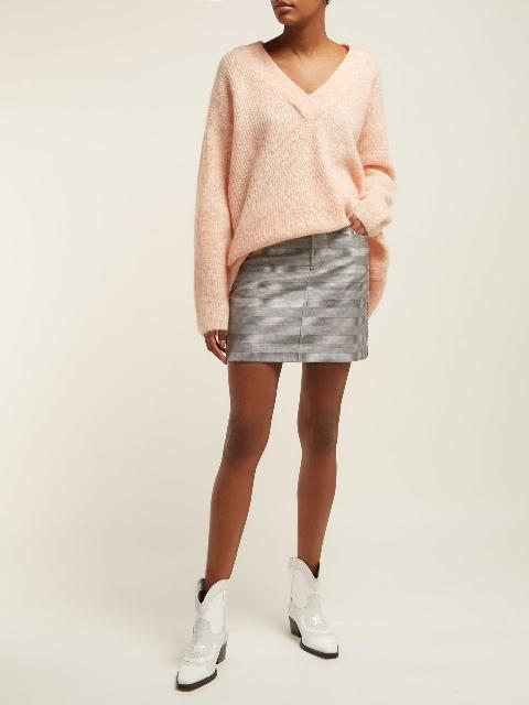With gray mini skirt and white leather low heeled boots