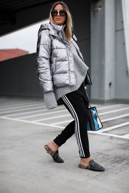 With gray oversized sweater, black and white sporty pants, black flat mules and colorful bag