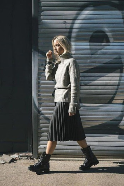 With gray turtleneck sweater, waist bag and pleated midi skirt