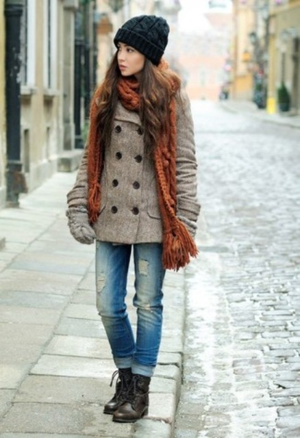 With hat, gray tweed jacket, cuffed jeans and brown knitted scarf