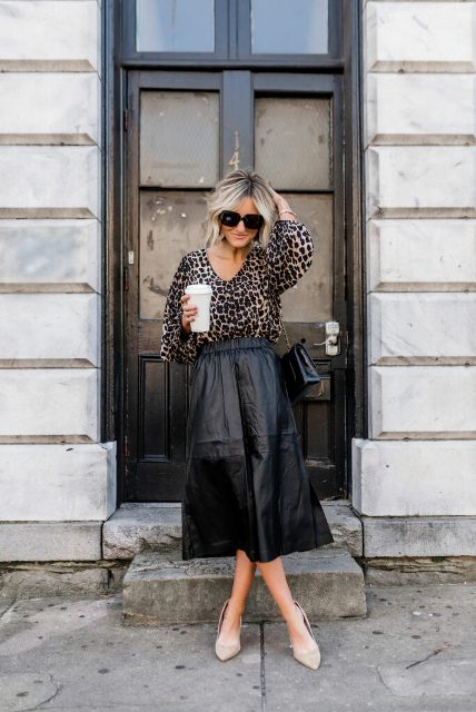 With leopard printed blouse, chain strap bag and beige shoes