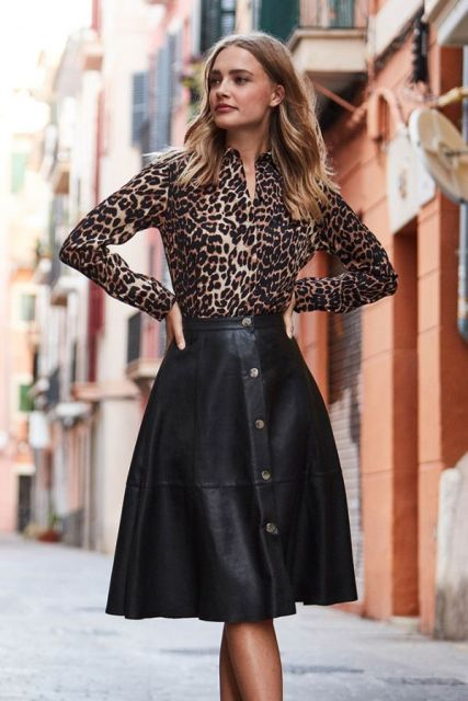 With leopard printed long sleeved blouse
