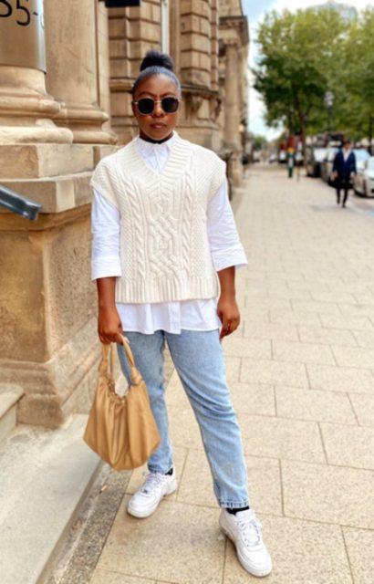 With light blue jeans, light brown bag, white shirt and white sneakers