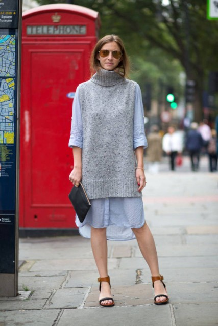 With light blue loose dress, black clutch and brown and blue sandals