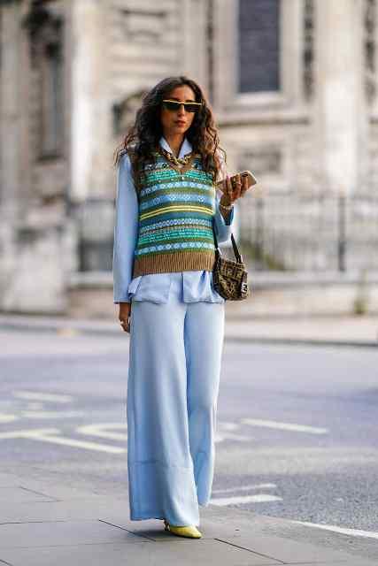 With light blue palazzo pants, shirt, printed bag and yellow shoes