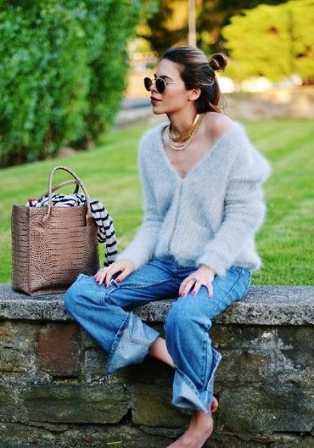 With loose jeans, leather tote bag and rounded sunglasses