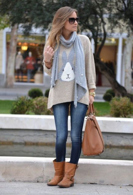 With loose sweater, gray embellished scarf, brown leather tote bag and skinny jeans