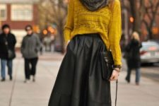 With mustard yellow loose sweater, faux fur scarf, black bag and black suede ankle boots
