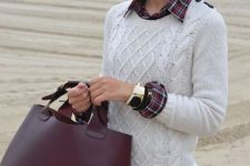 With navy blue jeans, sunglasses and marsala leather tote bag