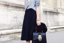 With navy blue midi skirt, black bag, jacket and purple velvet boots