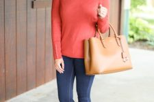 With navy blue skinny jeans, brown leather tote bag and brown flat shoes