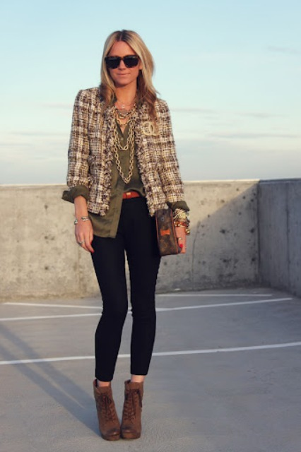 With olive green loose button down shirt, sunglasses, printed bag, golden necklace, skinny cropped pants, brown lace up ankle boots and red belt