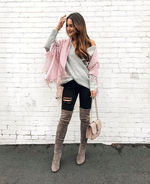 With pale pink fringe scarf, black distressed pants, gray suede over the knee boots and pale pink chain strap bag