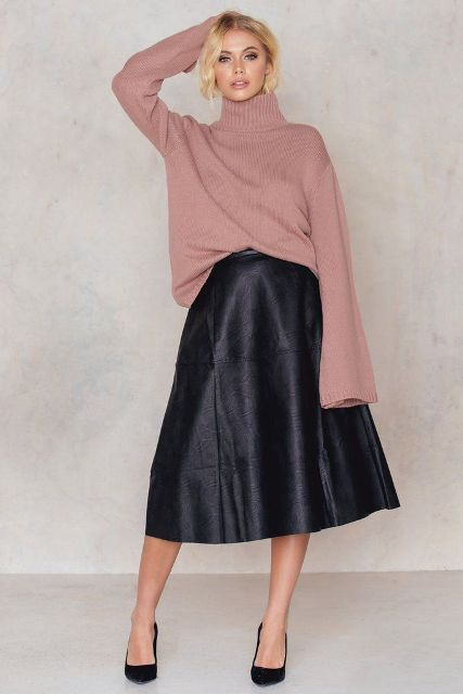 With pale pink oversized sweater and black pumps
