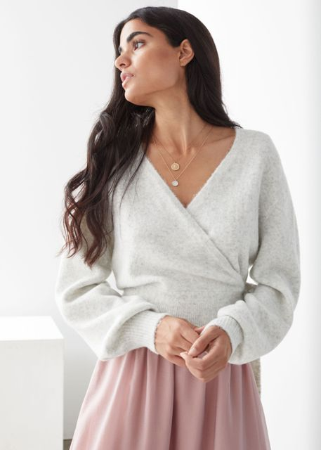 With pale pink pleated skirt