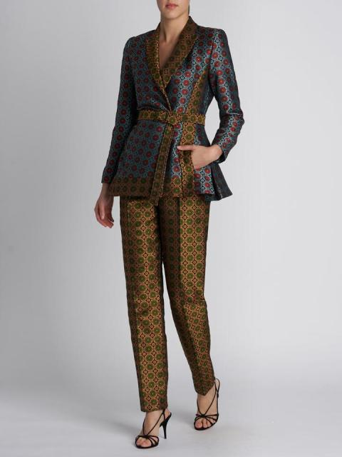 With printed trousers and black sandals