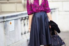 With purple printed shirt, black platform ankle boots and chain strap bag