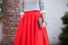 With red pleated A-line midi skirt, leopard printed clutch and beige patent leather pumps