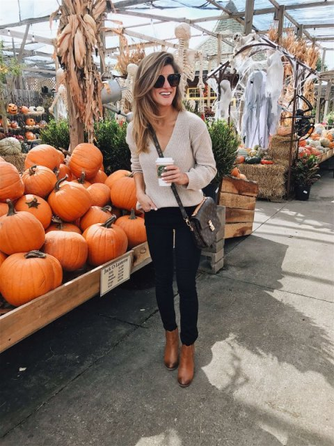 With skinny pants, brown ankle boots and printed crossbody bag