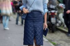 With striped button down shirt, chain strap bag, puffer skirt and striped pumps