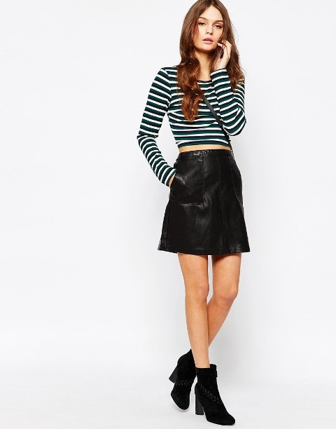 With striped crop shirt and black suede ankle boots