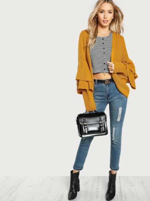 With striped crop shirt, cropped jeans, black leather bag and black ankle boots