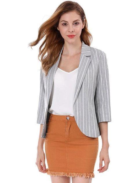 With white V-neck shirt and brown fringe mini skirt