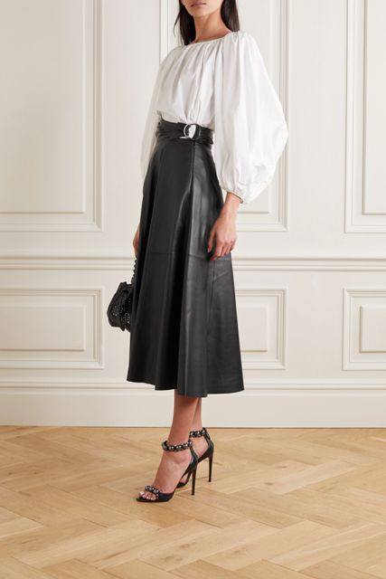 With white blouse, black bag and black embellished high heels