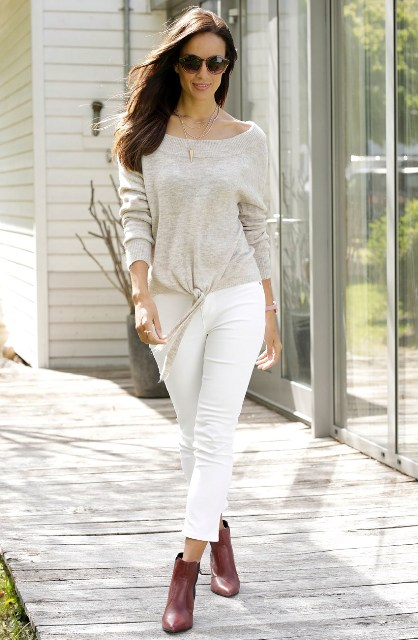 With white cropped pants and marsala ankle boots