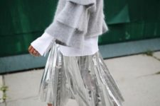 With white long sleeved shirt, silver pleated midi skirt and printed shoes