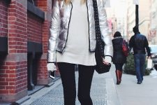 With white long sweater, white hat, black leggings, black bag and silver mid calf boots