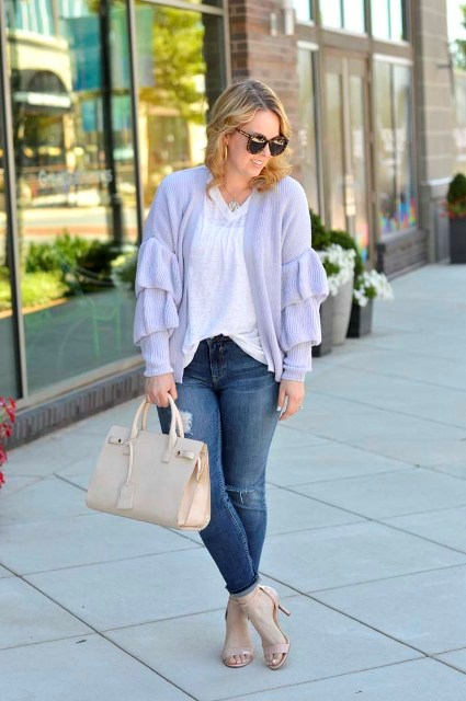 With white loose t shirt, beige leather bag and beige ankle strap high heels