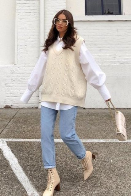 With white puff sleeve shirt, cuffed jeans, white bag and beige lace up boots