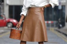 With white ruffled blouse, brown bag and leopard printed pumps