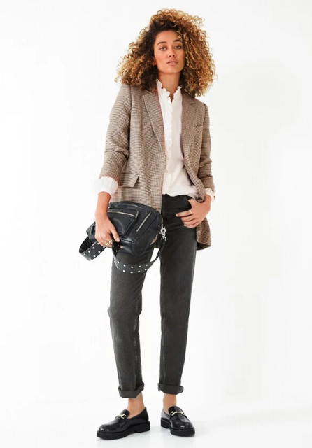 With white ruffled button down shirt, gray cuffed jeans, black embellished bag and black flat shoes