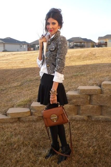 With white shirt, black pleated mini skirt, brown leather bag, black tights and black lace up ankle boots
