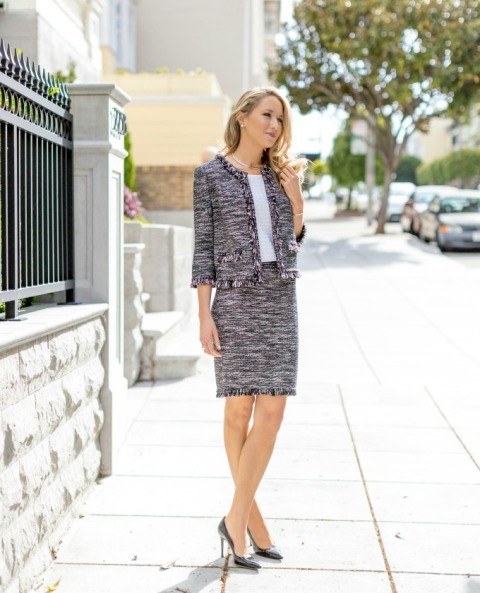 With white shirt, printed tweed pencil skirt and black patent leather pumps