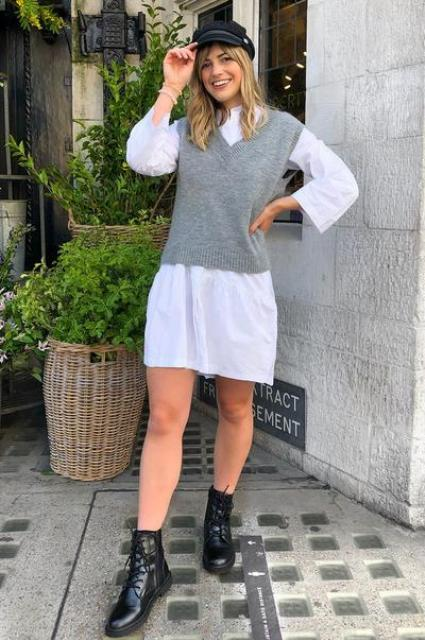 With white shirtdress, cap and black flat boots