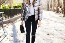 With white sweater, distressed skinny jeans, black bag and black and red boots