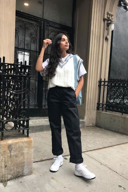 With white t-shirt, black cuffed trousers, light blue bag and white sneakers