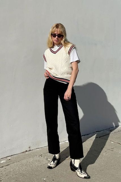 With white t-shirt, black pants and black and white boots