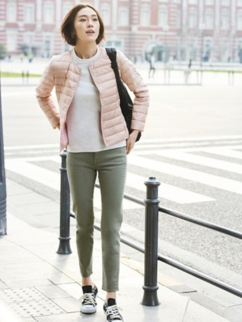 With white t-shirt, olive green cropped pants, black tote bag and black and white sneakers
