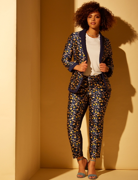With white t shirt, printed brocade pants and light blue ankle strap high heels