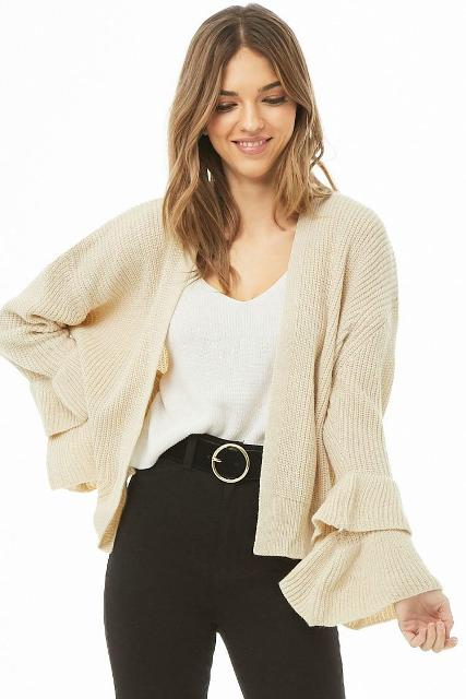 With white top and black belted pants