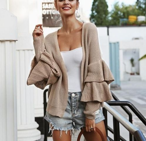 With white top and denim shorts