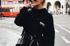 a black hoodie, a black zip mini leather skirt, a black bag for a sexy and bold fall look