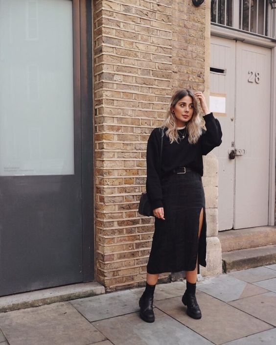 a black sweatshirt, a black denim midi skirt with a side slit, a black belt, blck combat boots and a bag for every day